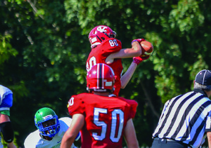 CVU's Tommy Zych makes a leaping catch in the fourth quarter during CVU's game vs Colchester on Saturday in Hinesburg.