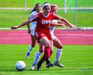 Observer photo by Al Frey Ali Bisaccia gets past her opponent during CVU's soccer match against Burlington High on Saturday.