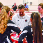 First year varsity coach, Mike Detch talks to his troups before CVU's vollayball match with Harwood on Thursday at CVU.