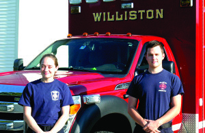 Observer photo by Jason Starr New hires Riley Moore and Gave Cummings are the first paramedics hired at the Williston Fire Department. They are finishing their probation period and are on track for paramedic certification later this fall.