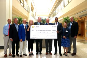Northfield Savings Bank chief executive officer Thomas Leavitt (center) presents representatives from the UVM Medical Center with a donation in support of the new Miller Building.