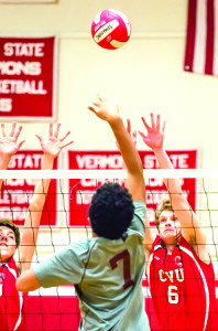 Garrett Dunn (6) goes up for the block during CVU's match with Lyndon on Friday afternoon in Hinesburg.