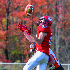 Tommy Zych (80) looks the pass into his hands during CVU's game vs Middlebury on Saturday in Hinesburg