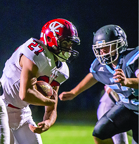 Zaq Ubaitel breaks through for a touchdown during CVU's football clash with the Wolves in So Burlington on Friday night