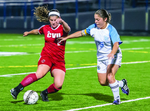 Observer photo by Al Frey Ali Bisaccia eludes her defender during CVU's game in South Burlington on Saturday.