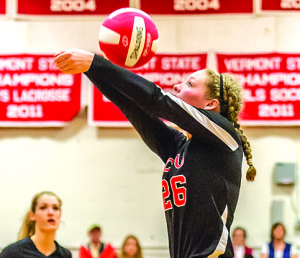 Makenzie Detch stretches to keep the ball in play during CVU's volleyball match versus Rice on 09Oct17 in Hinesburg