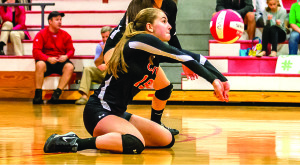 Tori Bergstein gets the dig during CVU's volleyball match versus Rice on 09Oct17 in Hinesburg