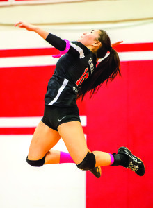 Mya Rendall makes the jump serve during CVU's match vs Vermont Commons School on 29Sep17 in Hinesburg.