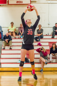 Natalie Senior sets the ball during CVU's match vs Vermont Commons School on 29Sep17 in Hinesburg.