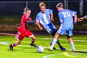 Ivan Llona takes on two SBHS defenders  during CVU's match vs SBHS in So Burlingtonon Monday the 2nd.