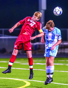 Nate Coffin battles for a header during CVU's match vs SBHS in So Burlingtonon Monday the 2nd.