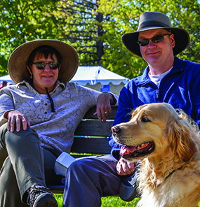 Scott and Mary-Elise Holley with Gordon the Golden take a brief rest at WIlliston's Chowder Challenge on Sunday.