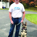 Observer courtesy photo Tom Radford, owner of Thin Blue Line K-9, with business partner Kayleigh.