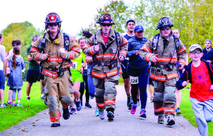 Three members of the Essex Fire Department ran the 5K Special Olympics Torch Run in full turn-out gear (less boots) including Scott packs (L to R) Cody Carpenter, AJ Leclair and Eric Fenton. Other runners went out to meet them at the finish.