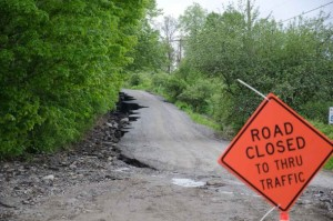 A road shows erosion damage after heavy rain. File photo by Josh Larkin/VTDigger
