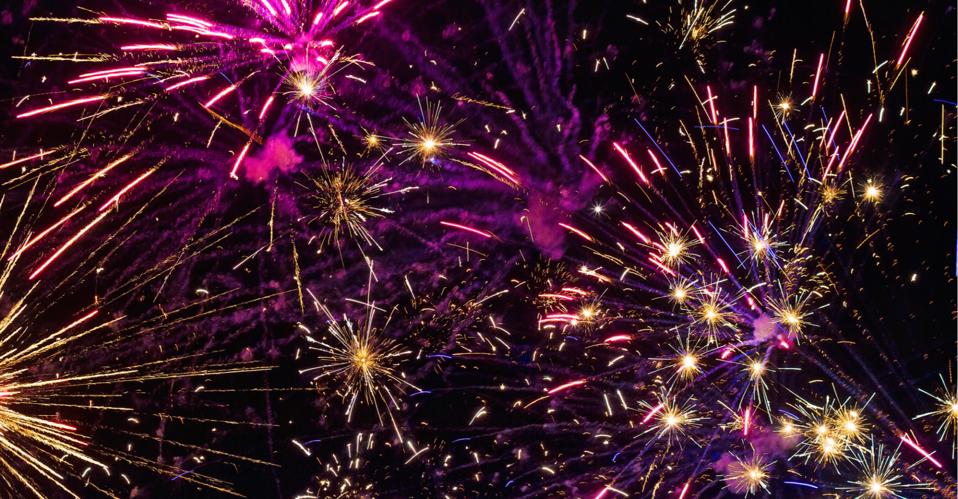 Colorful 4th of July fireworks fill the night sky