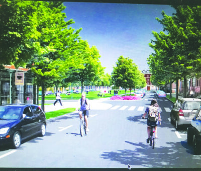 Vision of a future Trader Lane lined with trees, supporting bicyclists
