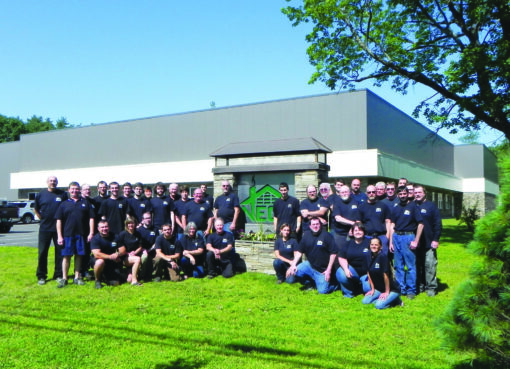 Employees at New England Chimney Supply gather for a photo outside the company's Williston Road headquarters