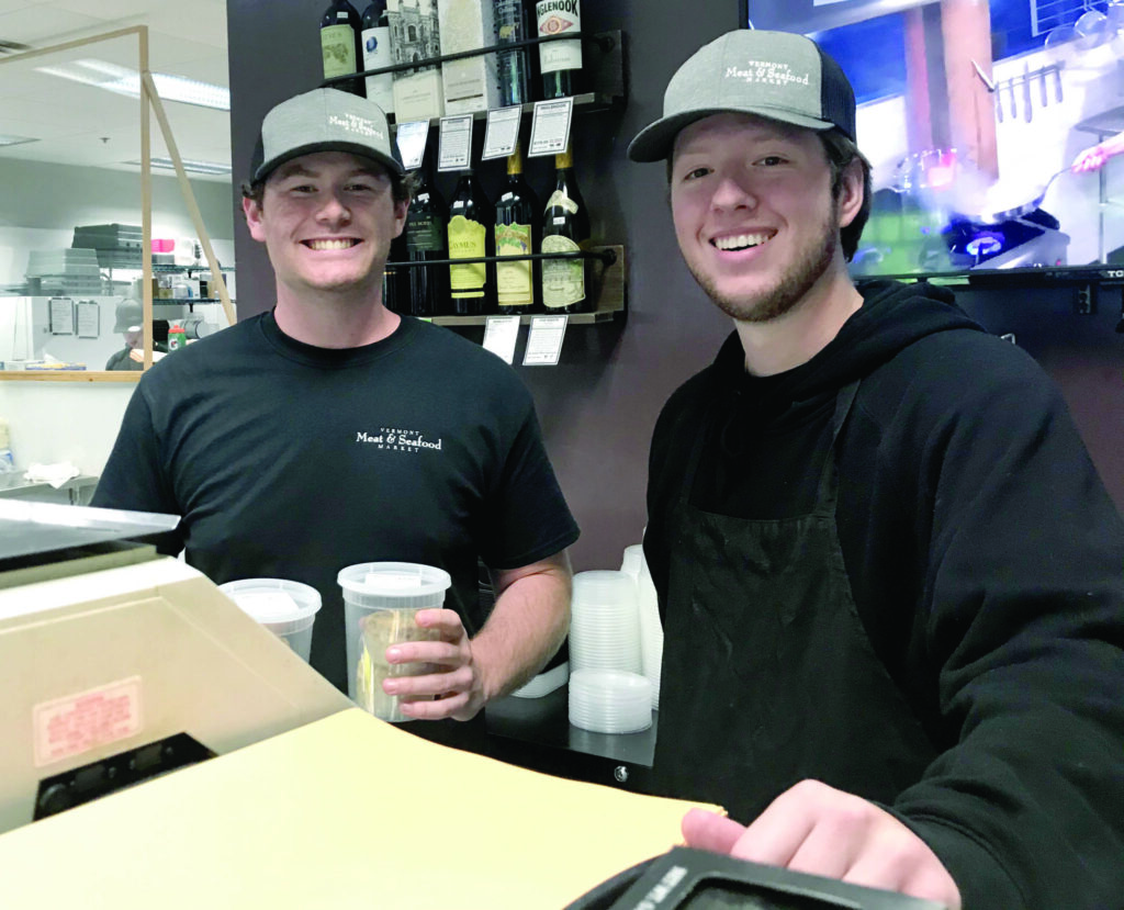 Maskless, smiling employees at Vermont Meat & Seafood