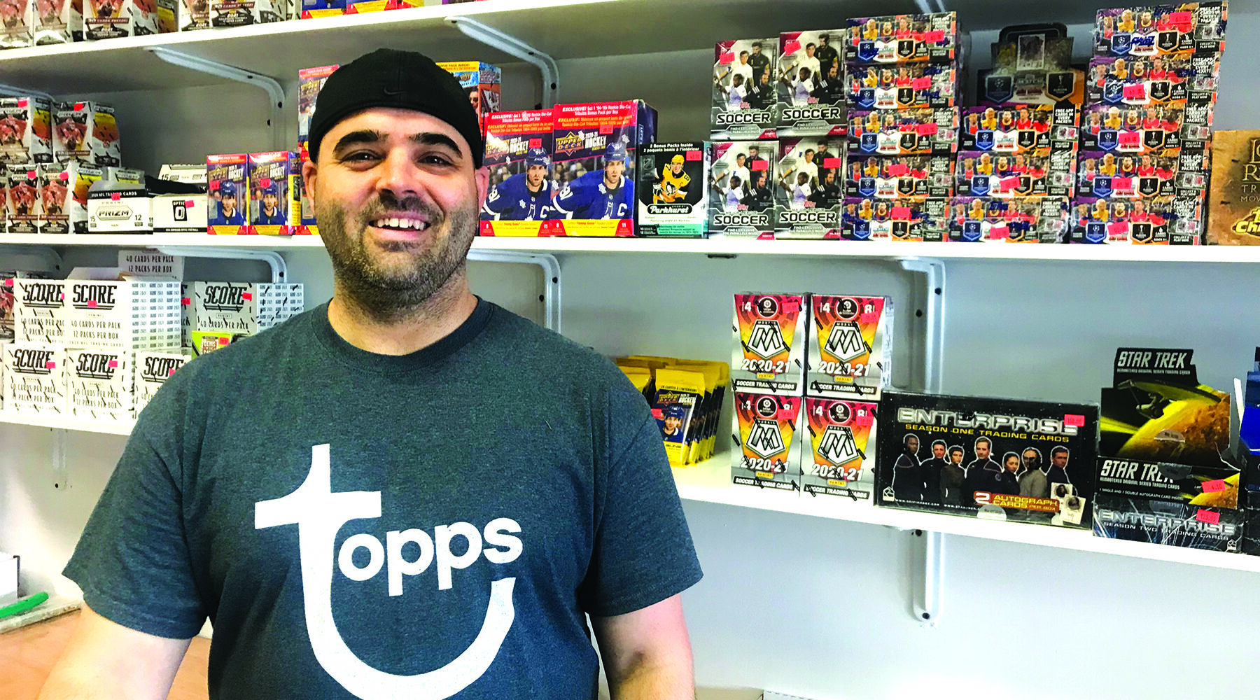 Jeff Francis of Main Street Sports Cards stands in his shop in Williston