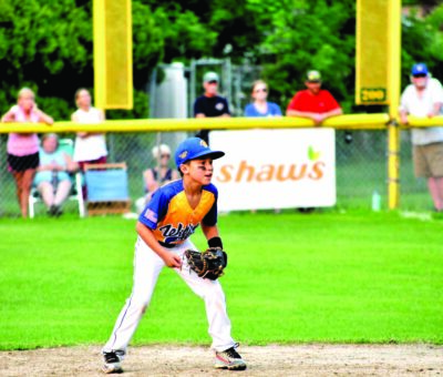 Dash Bufano playing infield for Williston Little League