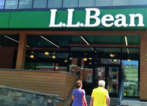Shoppers walk into LL Bean store in Burlington, Vermont on Tuesday, August 3, 2021.